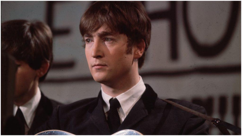 John Lennon performs with The Beatles.