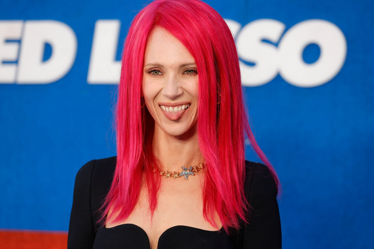 Juno Temple smiles, sticks out tongue in hot pink hair