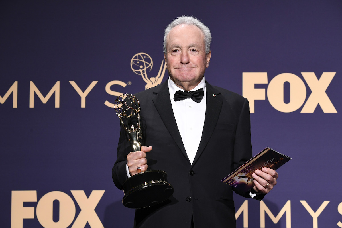 Lorne Michaels in a tuxedo holding an Emmy statue at the 71st annual Emmy Awards.
