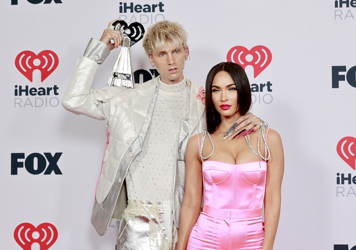 (L-R) Machine Gun Kelly and Megan Fox attend the 2021 iHeartRadio Music Awards in Los Angeles, California.
