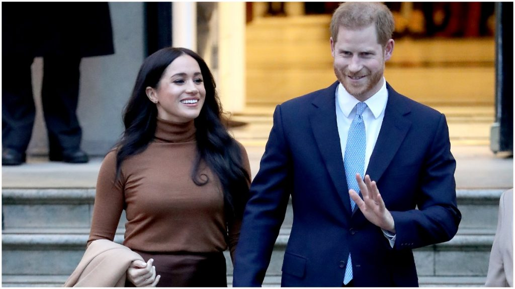Meghan Markle and Prince Harry pose for a royal photo op.