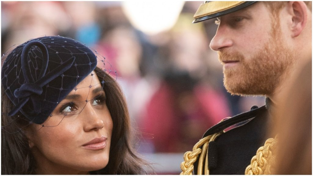 Meghan Markle and Prince Harry look at one another in a photo taken at a royal event.