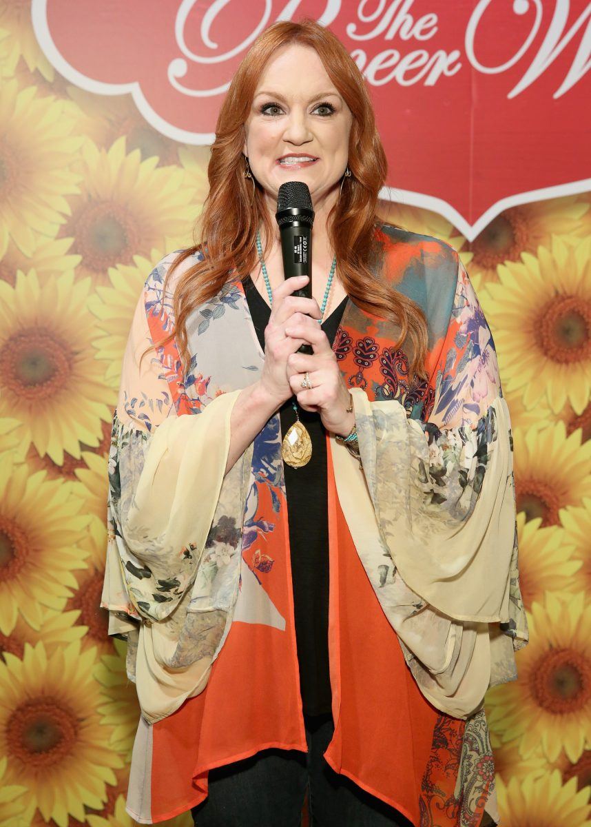 Ree Drummond holding a microphone and speaking to the audience