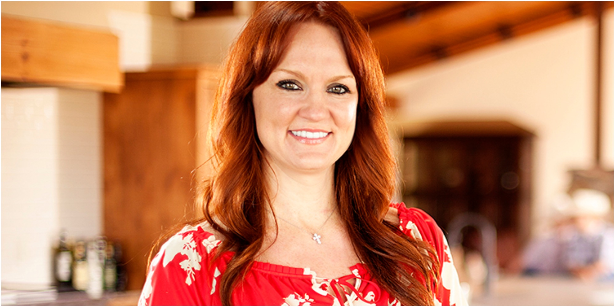 Ree Drummond smiles wearing a red shirt