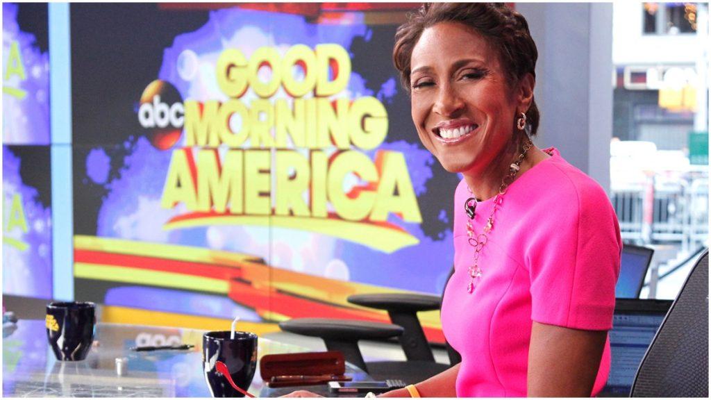 Robin Roberts at the anchor desk of Good Morning America.