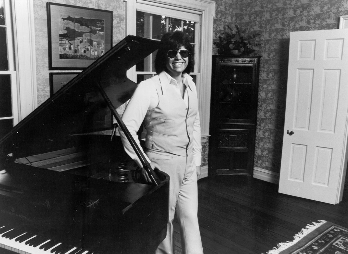 Ronnie Milsap with a piano