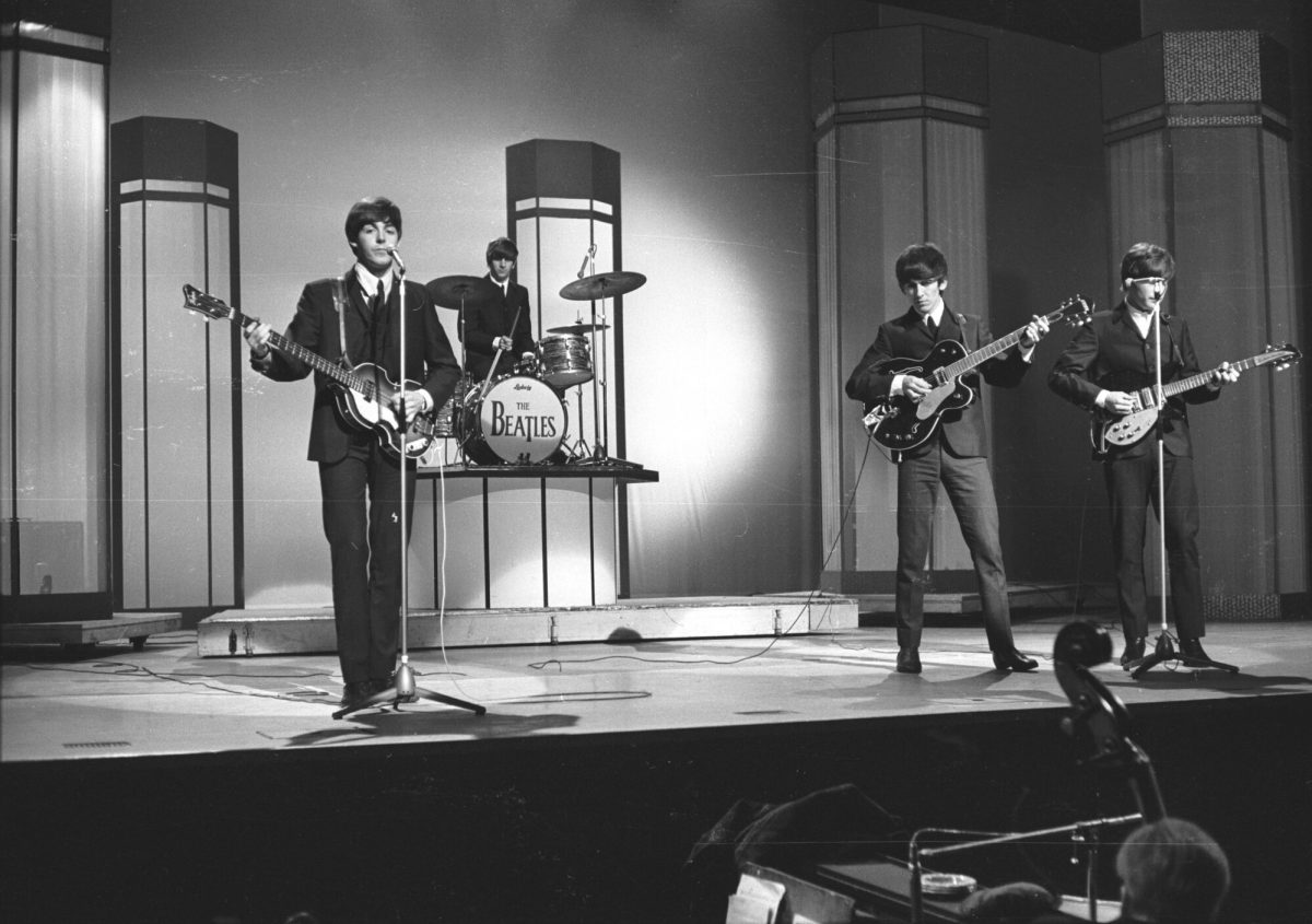 The Beatles, from left to right: Paul McCartney, Ringo Starr, George Harrison, and John Lennon in concert at the London Palladium.