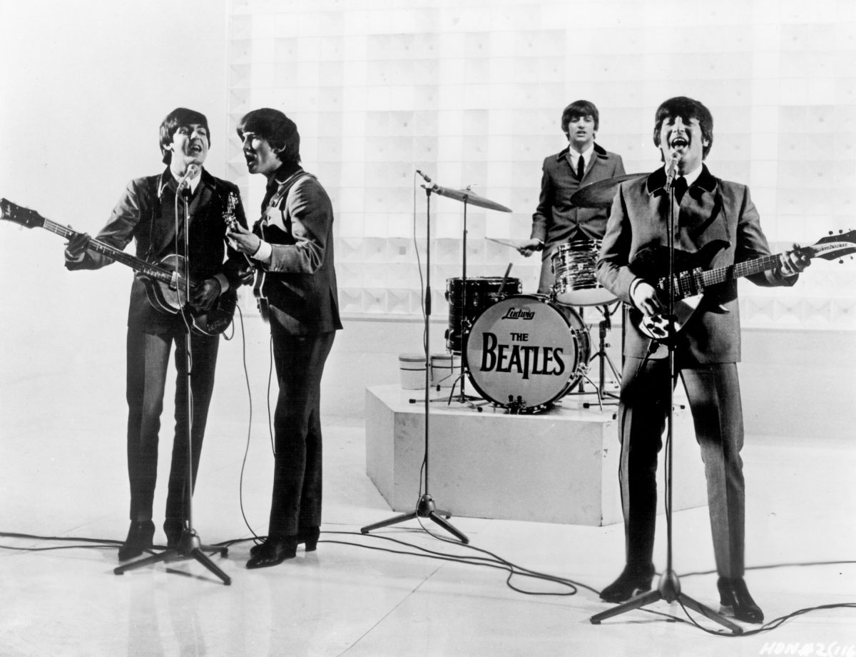 The Beatles on a stage