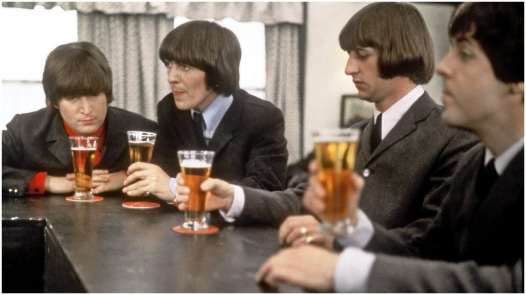 The Beatles drink a beer in a still from their movie 'Help!' which was released in 1965. (L-R) John Lennon, George Harrison, Ringo Starr and Paul McCartney.