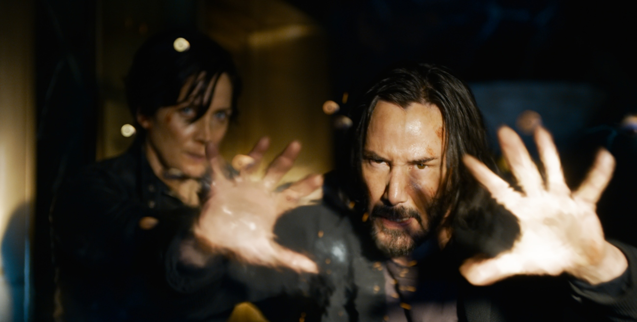 Carrie-Anne Moss as Trinity and Keanu Reeves as Neo in 'The Matrix Resurrections'