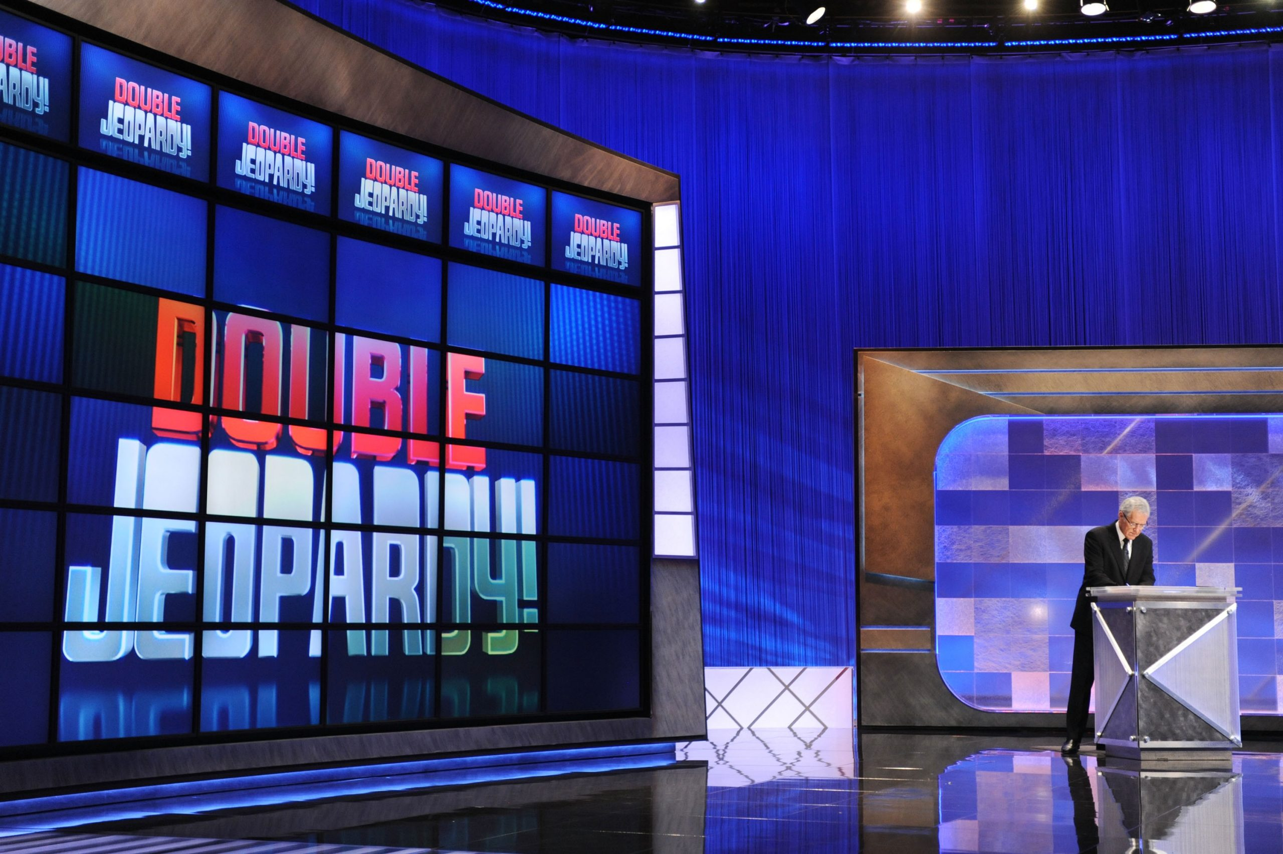 Game show host Alex Trebek rehearses his lines on the set of the 'Jeopardy!' Million Dollar Celebrity Invitational Tournament Show