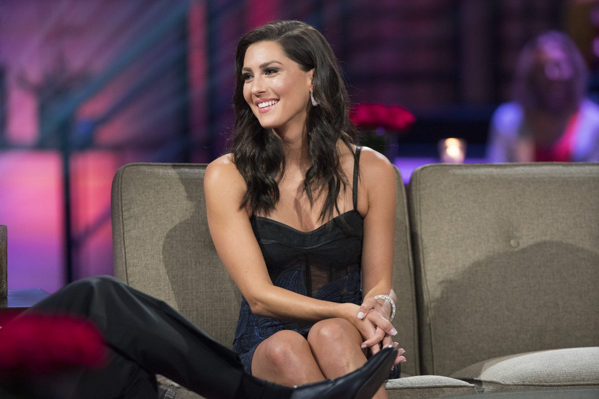 Bachelor in Paradise star Becca Kufrin wears a black dress at the 'Men Tell All' during her season of 'The Bachelorette.'