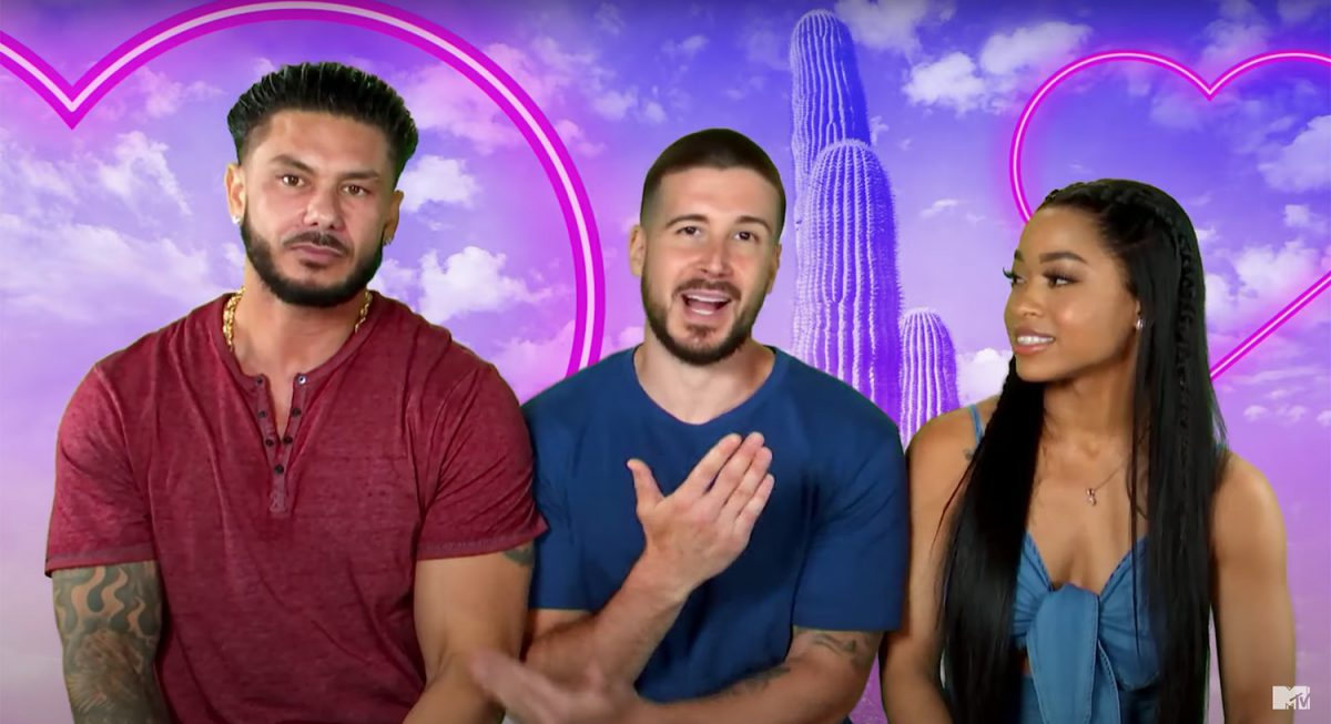 Pauly DelVecchio, Vinny Guadagnino, and Nikki Hall talk to the camera with a green screen image behind them for 'Double Shot at Love' Season 3