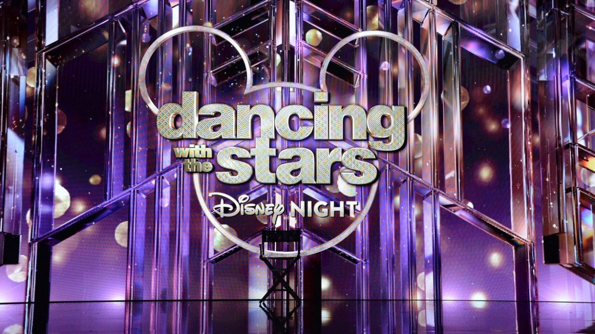 'DWTS' Disney Night logo projected onto the screen in the ballroom with a director's chair in view