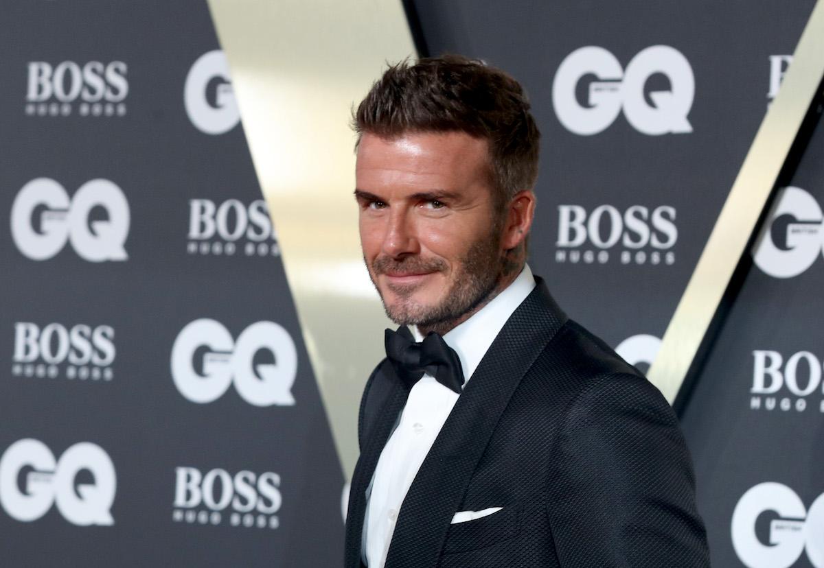 David Beckham wears a tuxedo at an event.