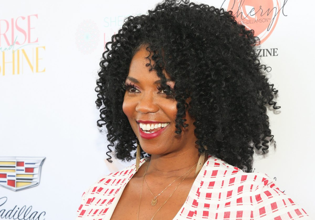 Days of Our Lives features Vanessa Estelle Williams joining the cast, pictured here in a red and white dress