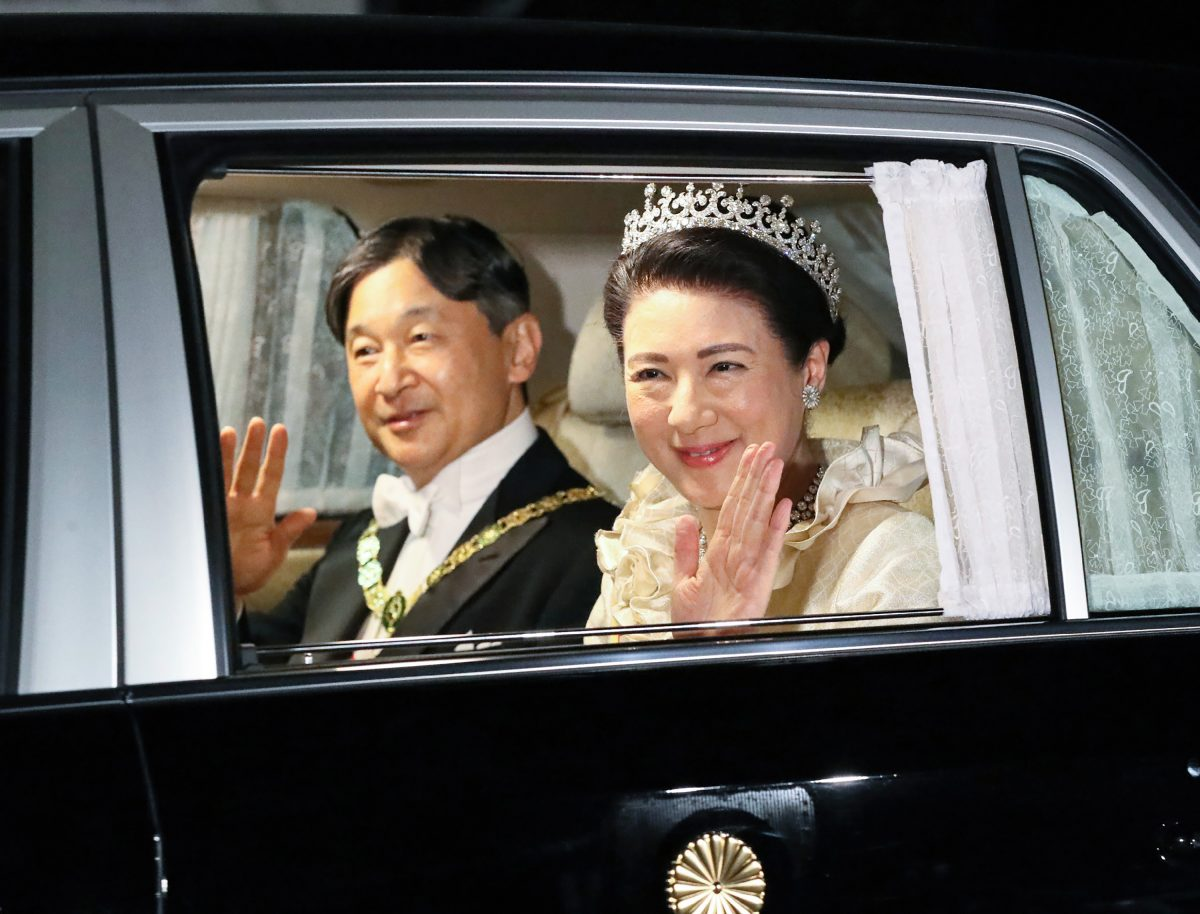 Emperor Naruhito and Empress Masako smile and wave as they depart Akasaka Palace for the court banquet at the Imperial Palace