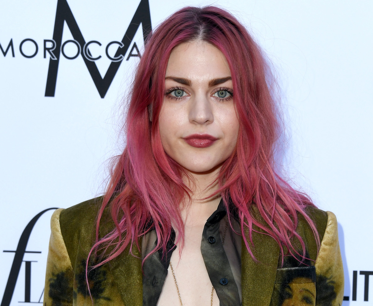 Frances Bean Cobain smiling in front of a white background