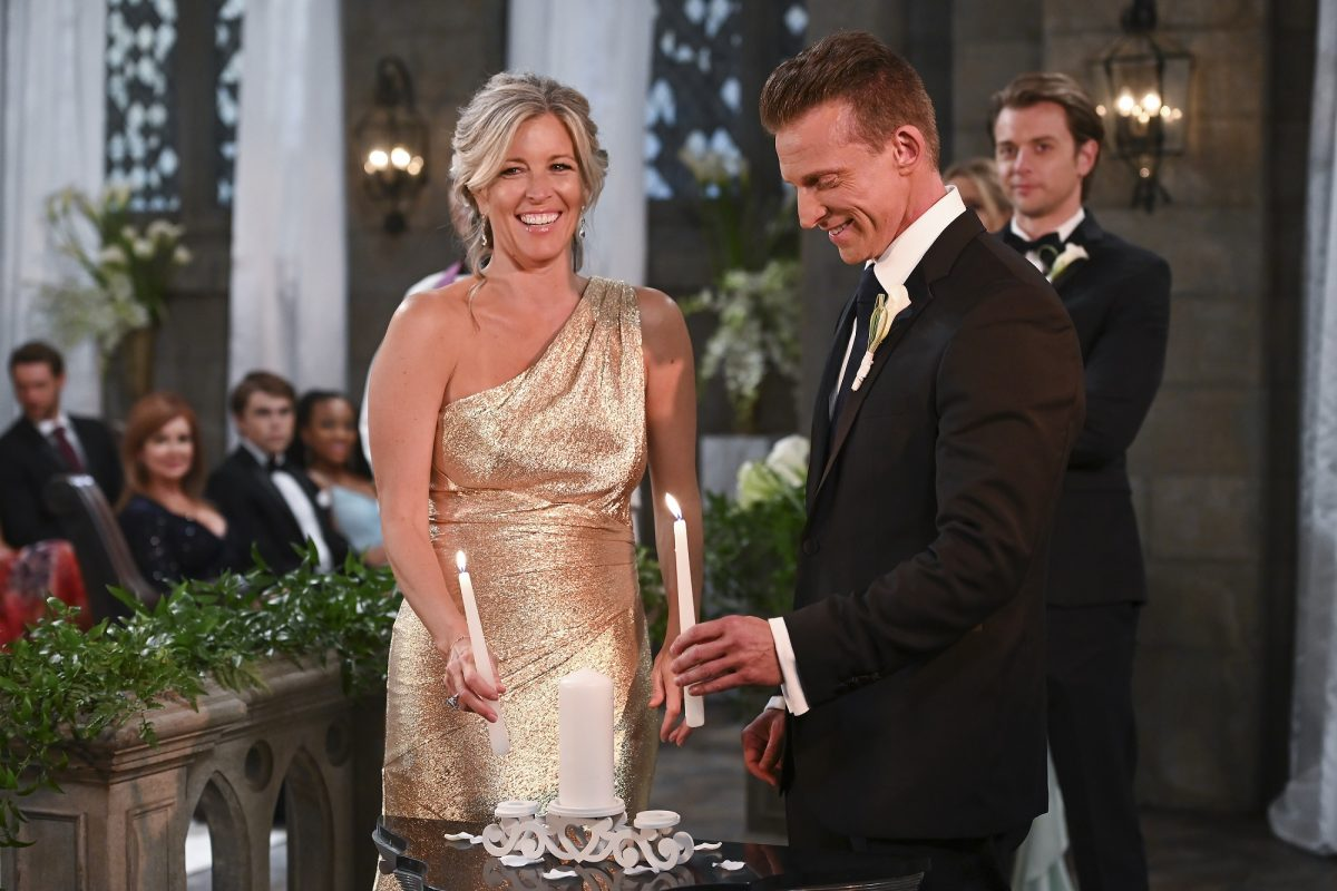 General Hospital spoilers focus on Carly, pictured here in an off-the-shoulder gold dress and smiling
