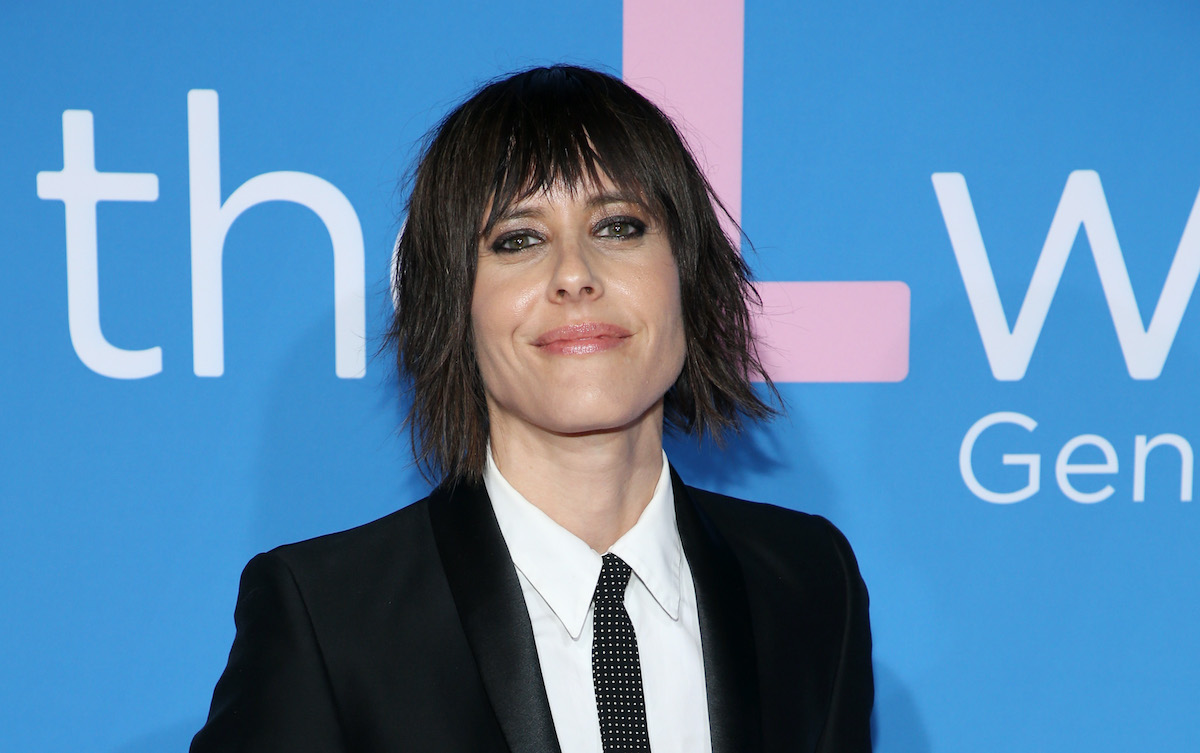 Katherine Moennig wears a dark suit on the red carpet at an event for the Showtime series 'The L Word: Generation Q'