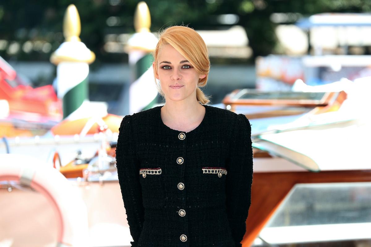Kristen Stewart smiling in front of a marina