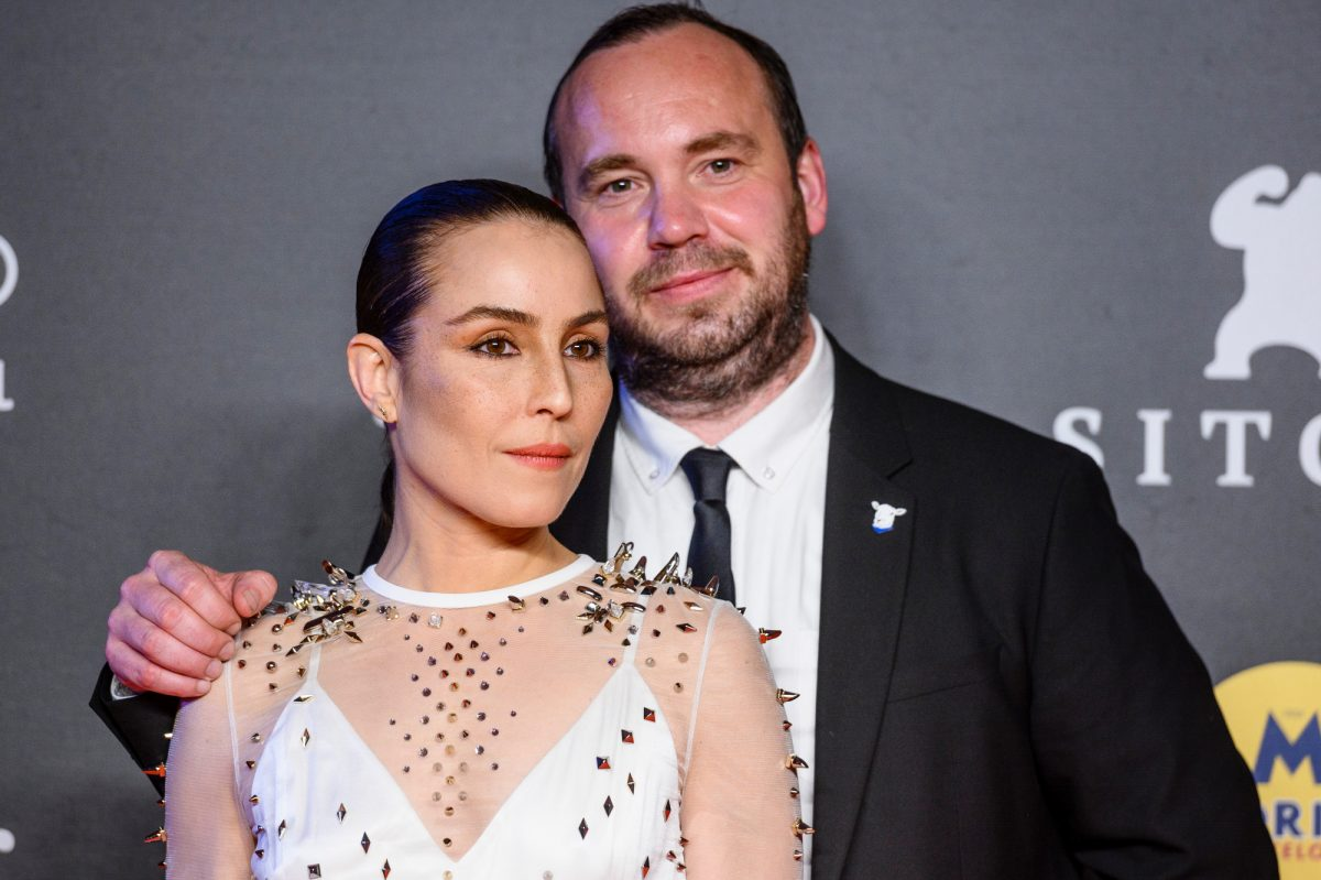 'Lamb' actor Noomi Rapace and director Valdimar Jóhannsson standing in front of a stop and repeat