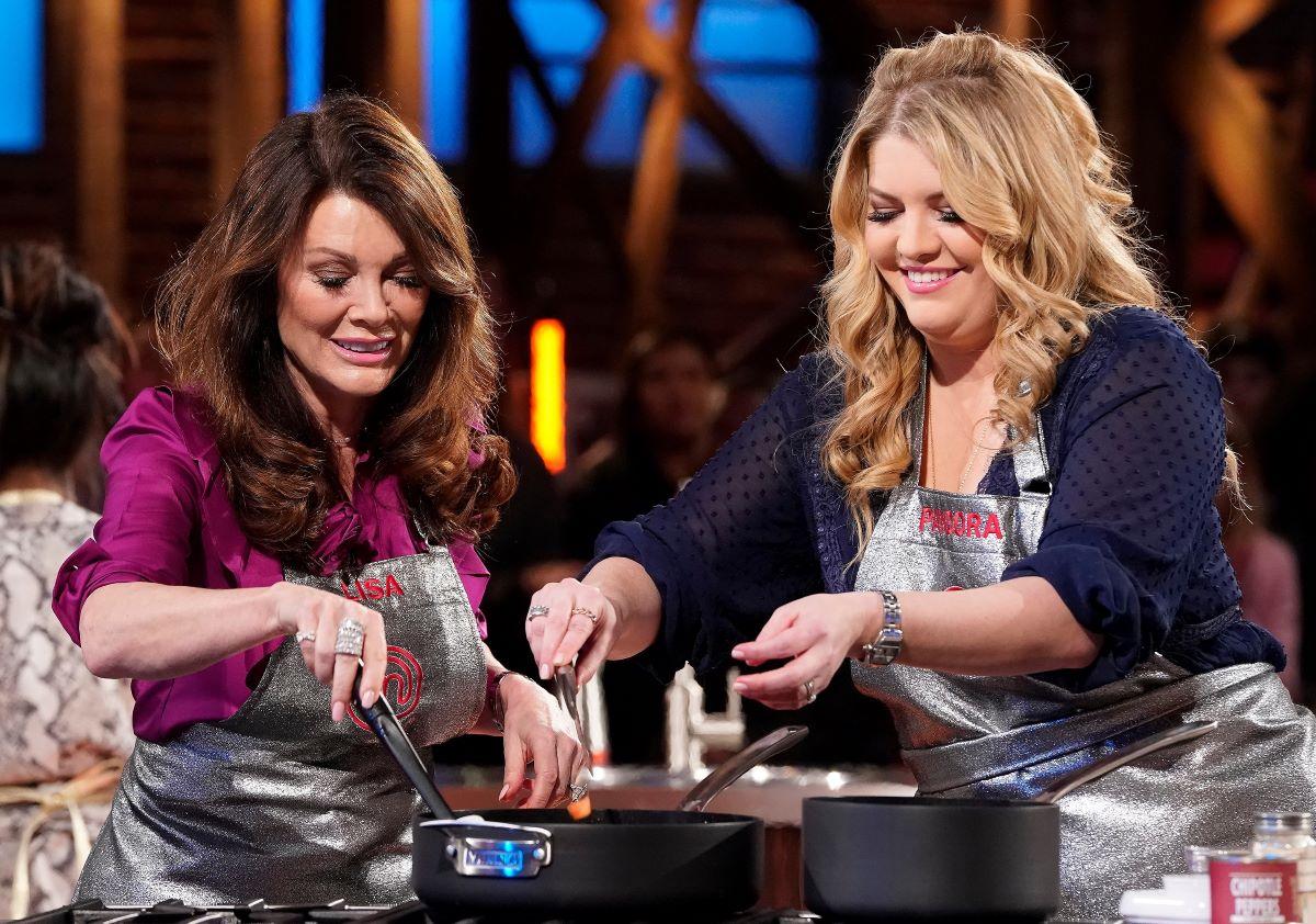 Lisa Vanderpump and Pandora Sabo cooking, wearing aprons