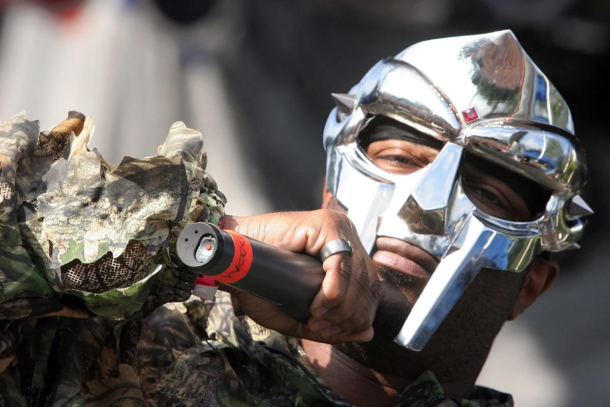 MF Doom holding a microphone