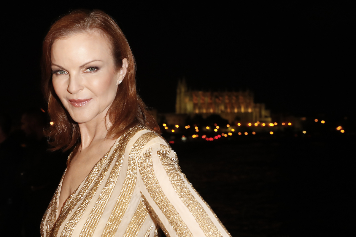 Marcia Cross will appear in 'You' Season 3. In this photo, she smiles and wears a striped top.