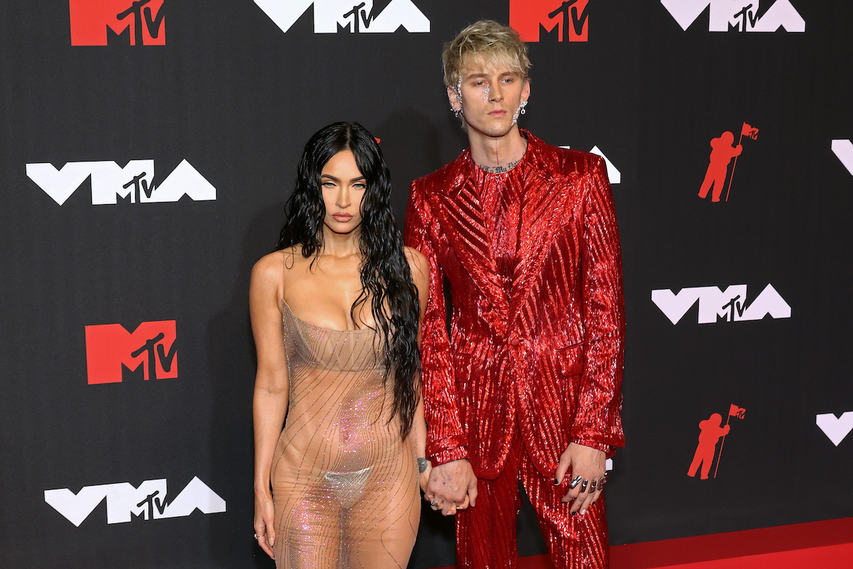 Megan Fox and Machine Gun Kelly pose together at an event.