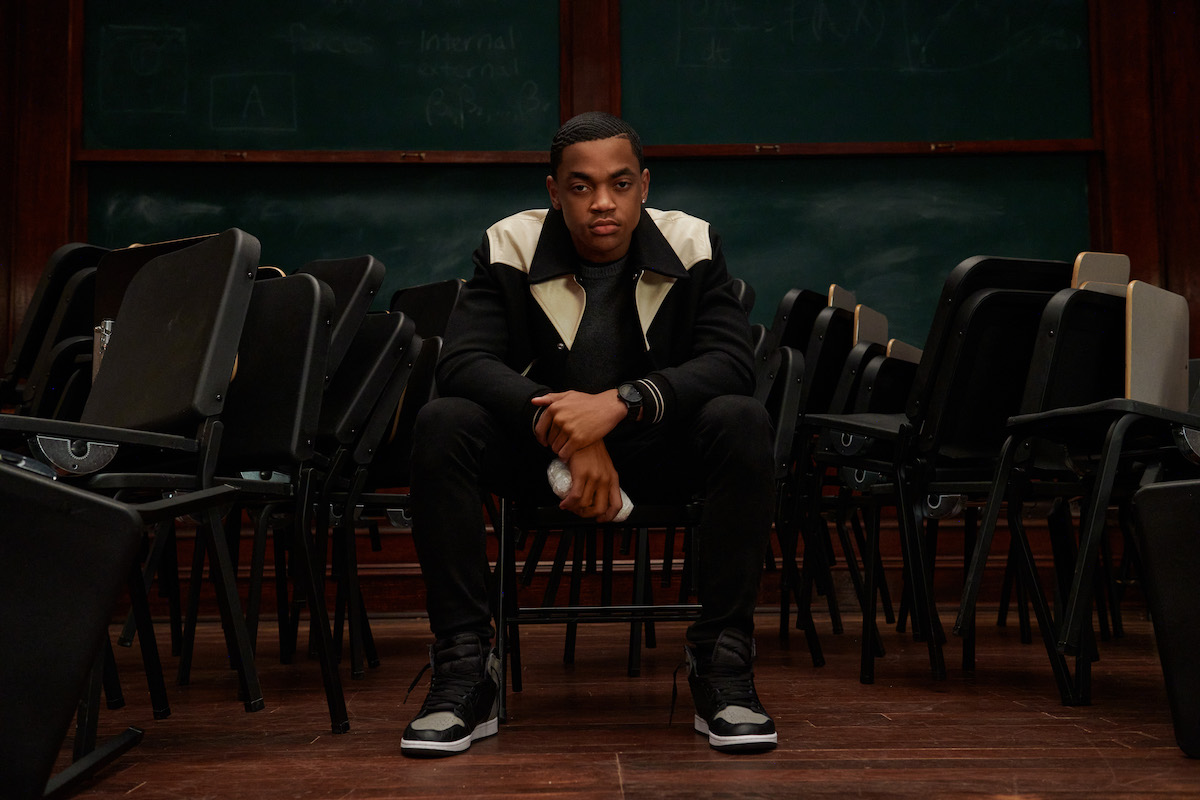 Michael Rainey Jr as Tariq St. Patrick siting in a chair in 'Power Book II: Ghost'