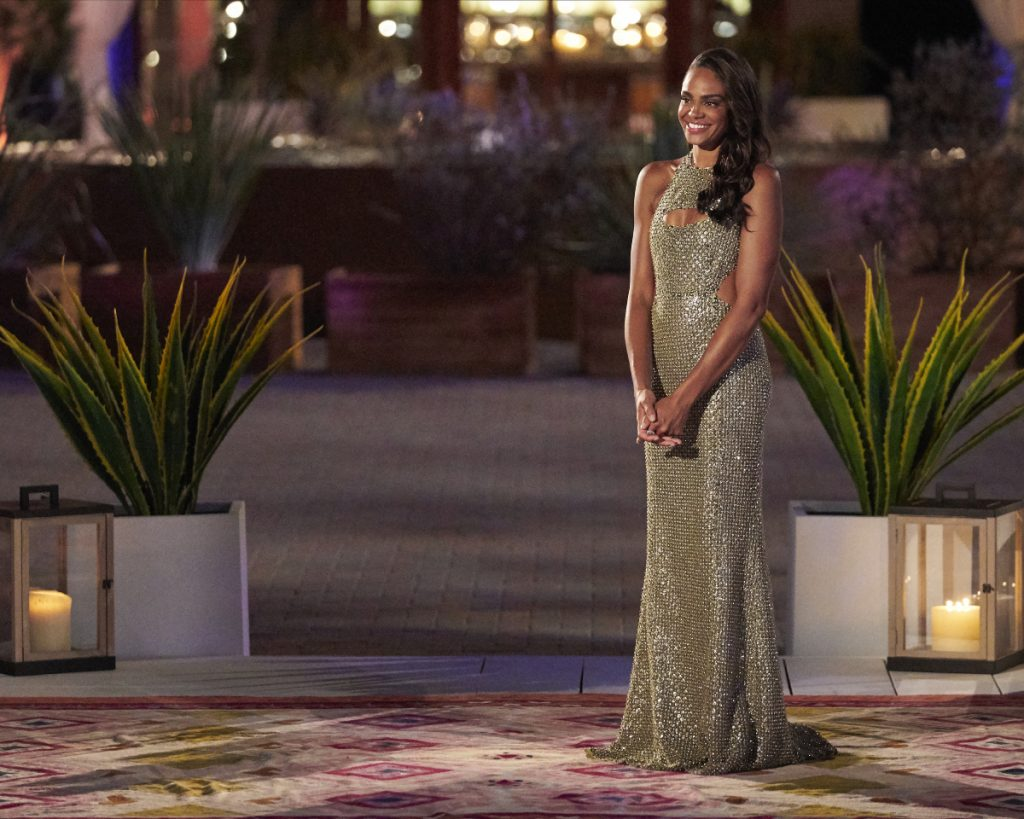 Michelle Young waits to meet her men wearing a sequined gown on night one of The Bachelorette Season 18.