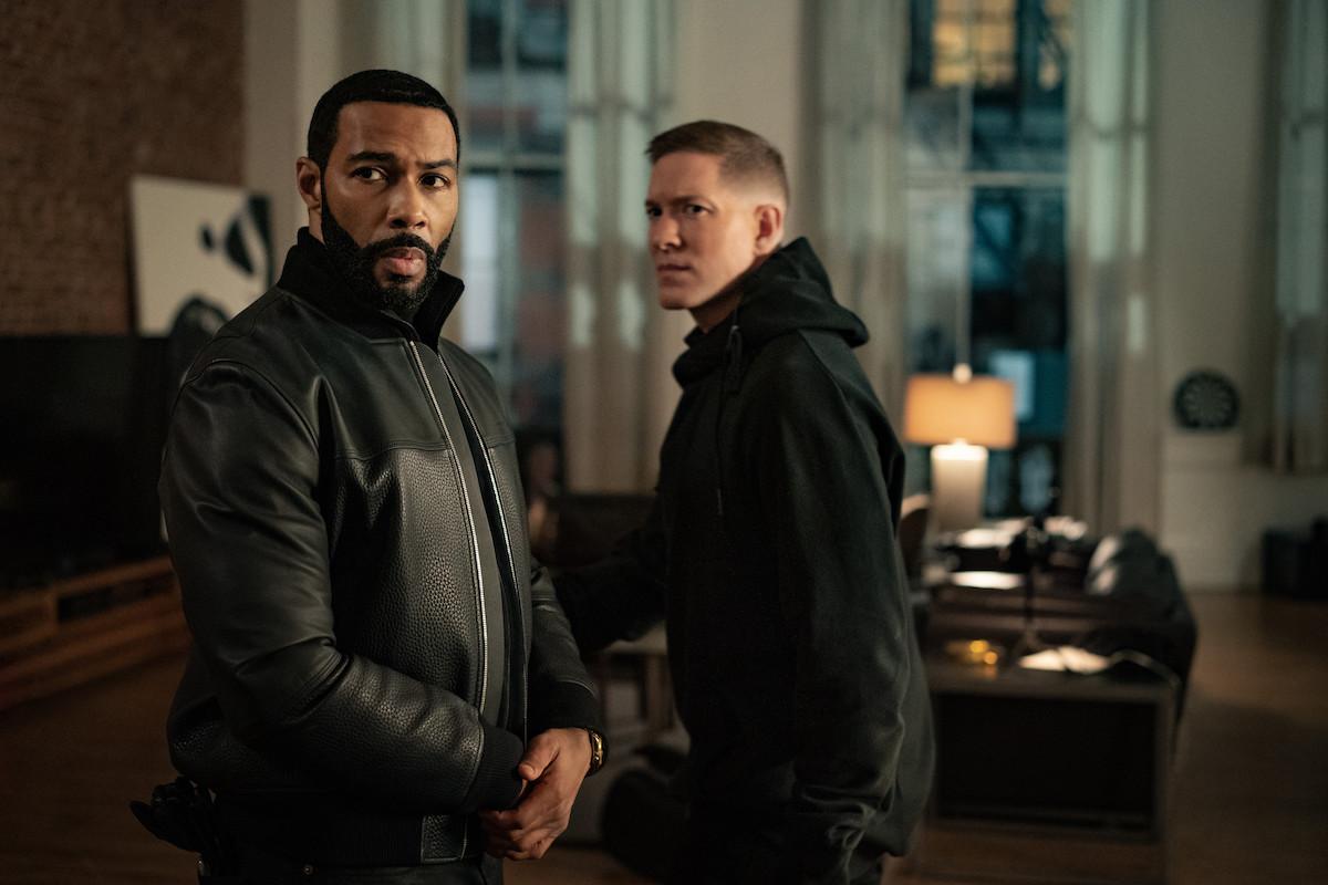 "Omari Hardwick as James ""Ghost"" St. Patrick and Joseph Sikora as Tommy Egan glaring while wearing all black in 'Power'"