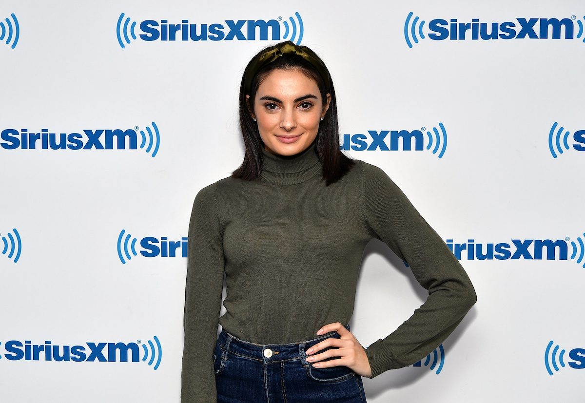 """Paige DeSorbo from """"Summer House"""" poses in a turtleneck and jeans at an event."""
