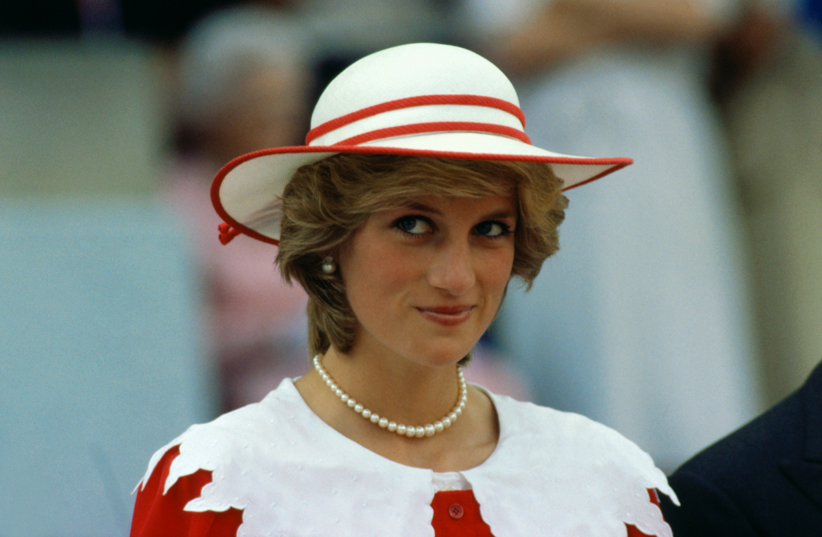 Princess Diana interview moments are iconic, just like this look of Princess Diana wearing a red and white outfit, looking up and to the left