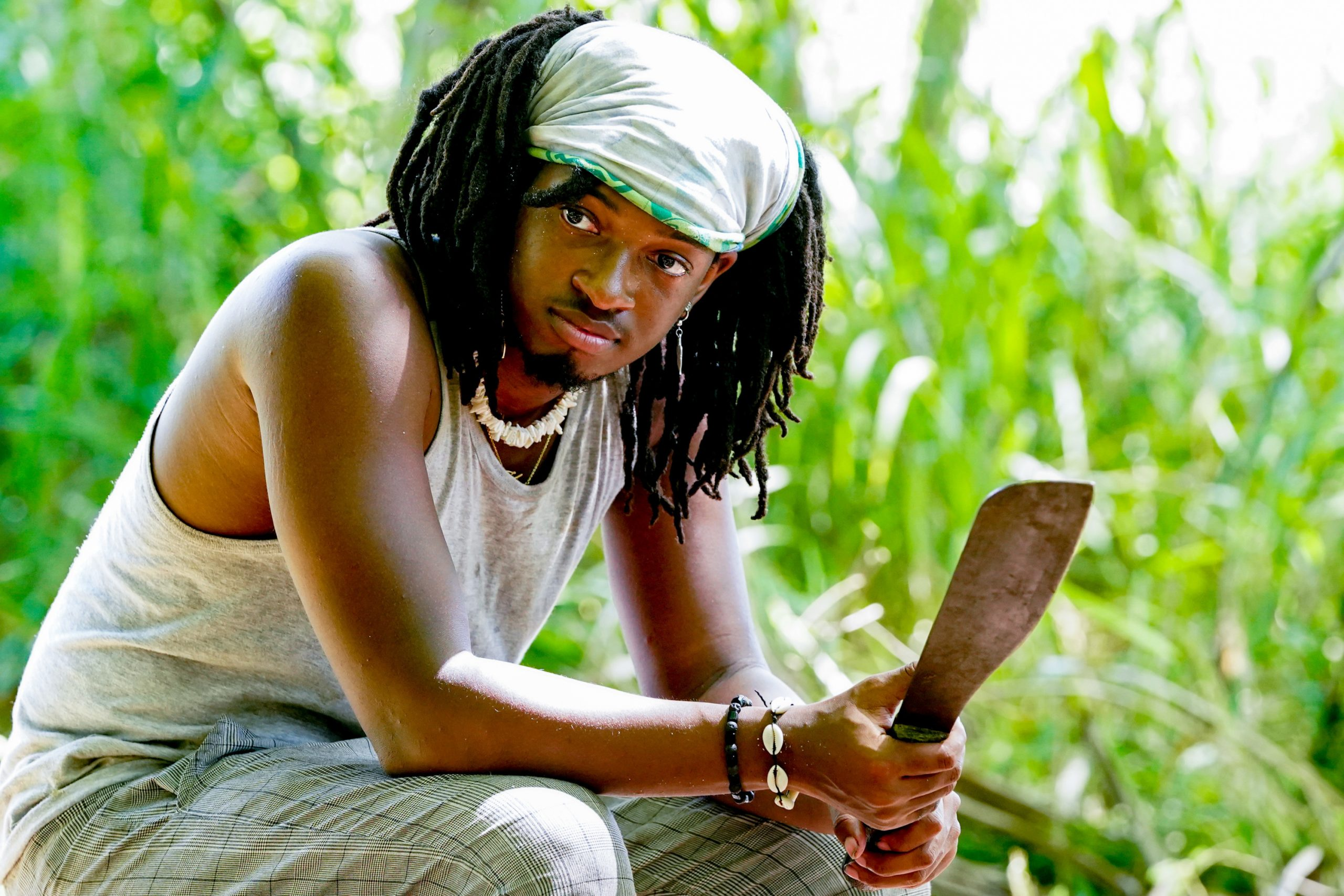 Jairus Robinson on 'Big Brother 23' sits down holding a machete.