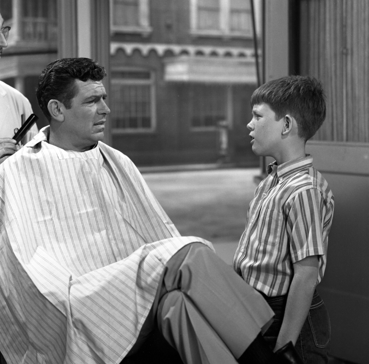 Actors Andy Griffith and Ron Howard in a scene from 'The Andy Griffith Show'