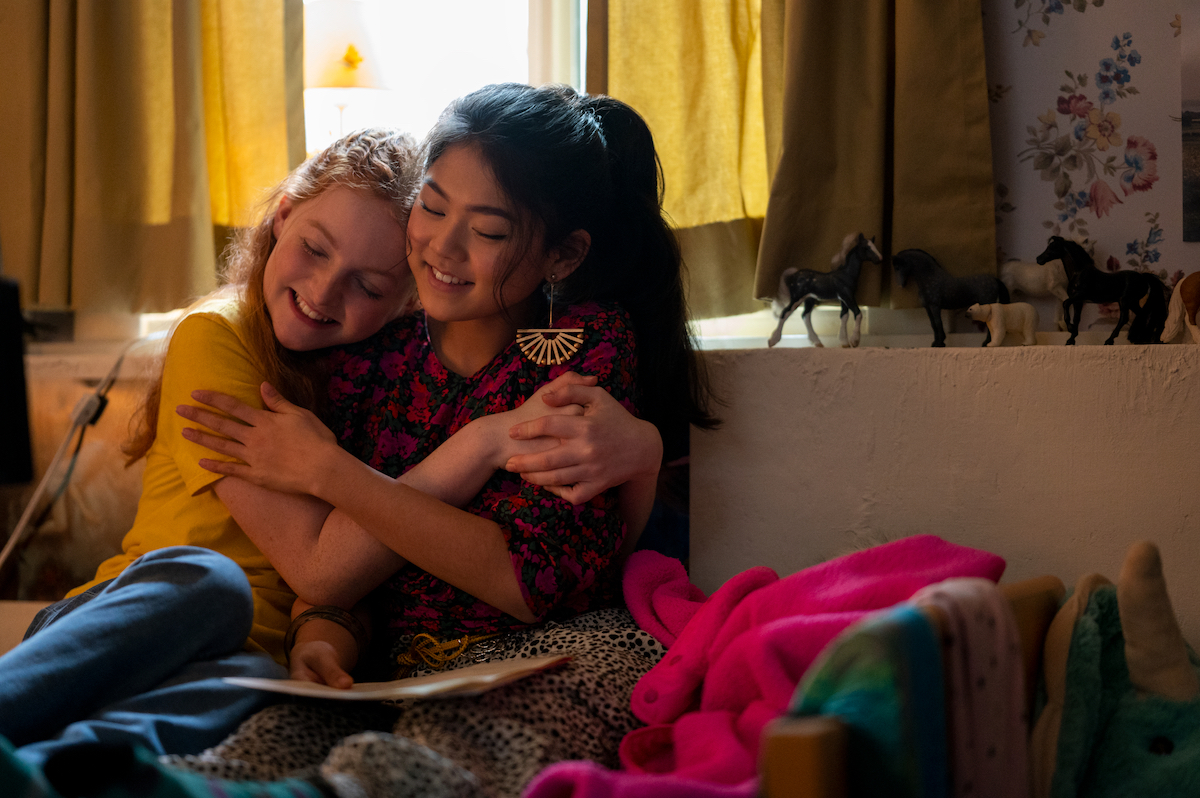 Claudia with her arms around Mallory in 'The Baby-Sitters Club' Season 2