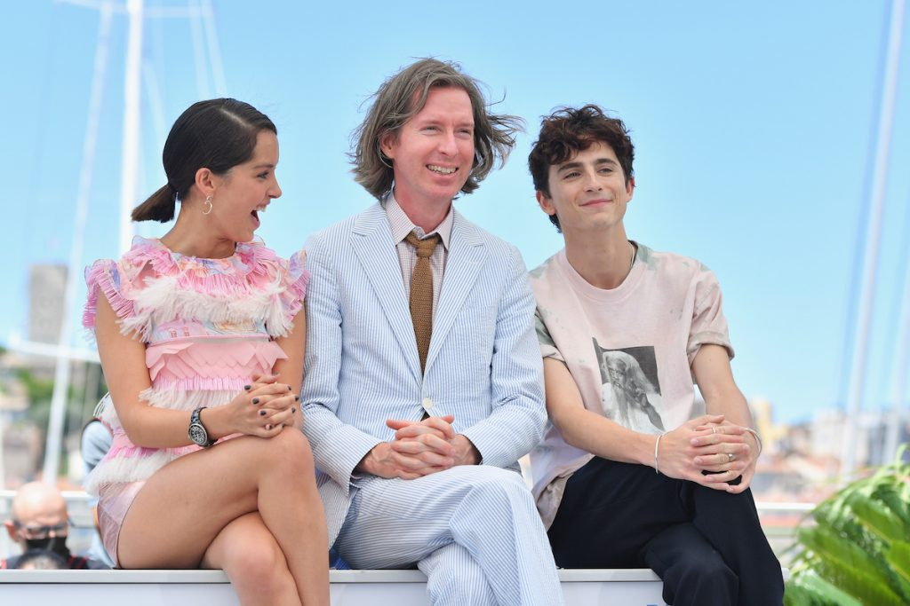 Lyna Khoudri, Wes Anderson and Timothée Chalamet attend the The French Dispatch photo-call at the 2021 Cannes Film Festival