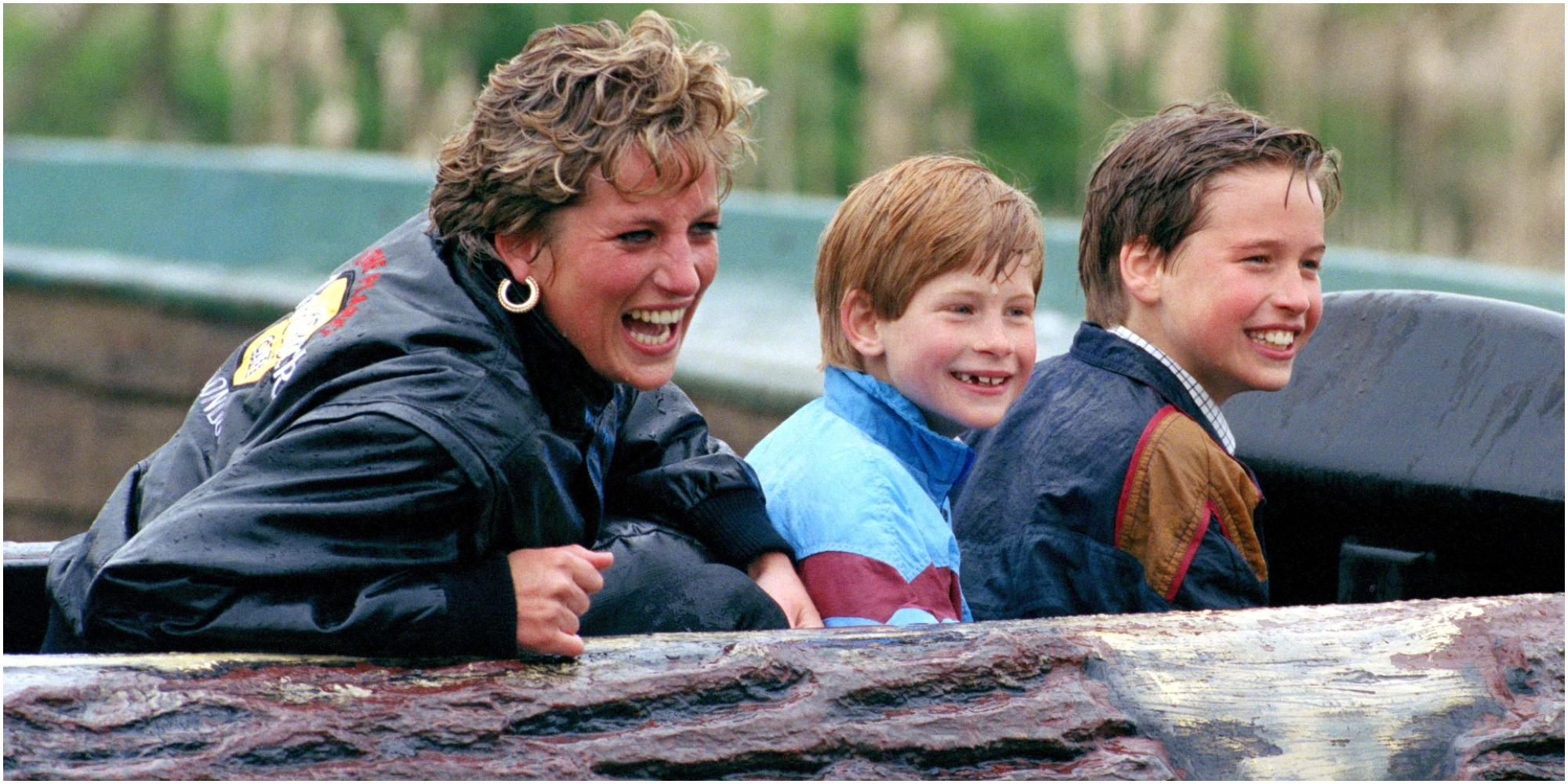 Princess Diana, Prince Harry and Prince William on a ride in a United Kingdom amusement park.