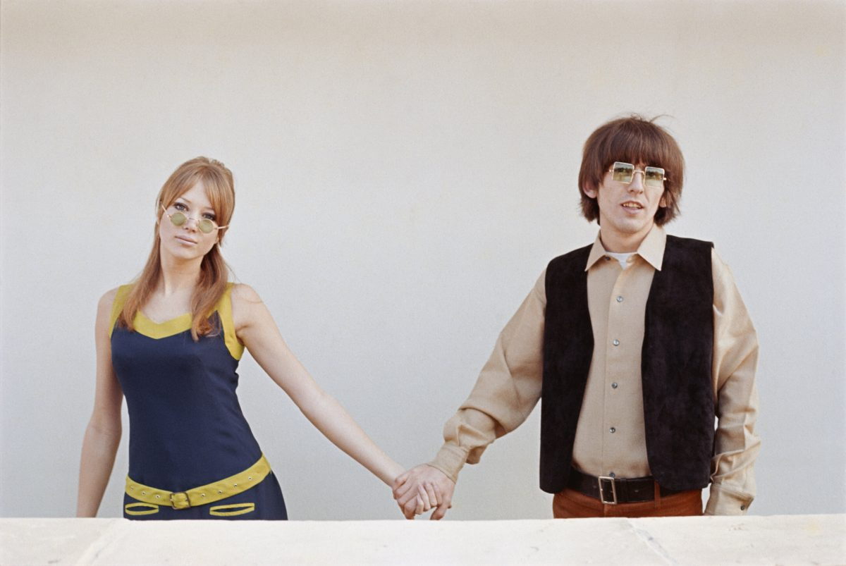 George Harrison (1943 - 2001) of The Beatles holds hands with his wife, model Pattie Boyd, circa 1970.